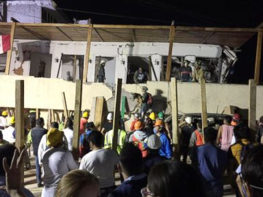 Rescuers desperately searching for survivors in collapsed school in Mexico City