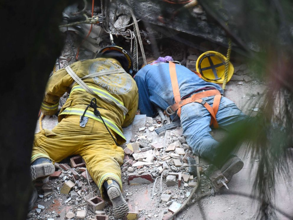 PHOTO: A firefighter and a rescuer search for survivors in Mexico City, Sept. 20, 2017, after an earthquake hit central Mexico on Sept 19, 2017.