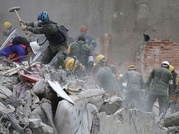 Rescue workers scramble to find trapped school children in Mexico City