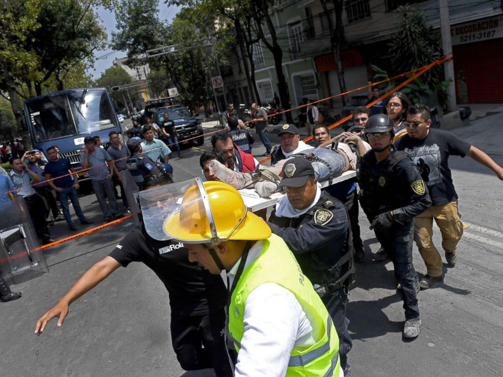 PHOTO: Rescuers carry on a stretcher a person wounded during a quake in Mexico City, Sept. 19, 2017.