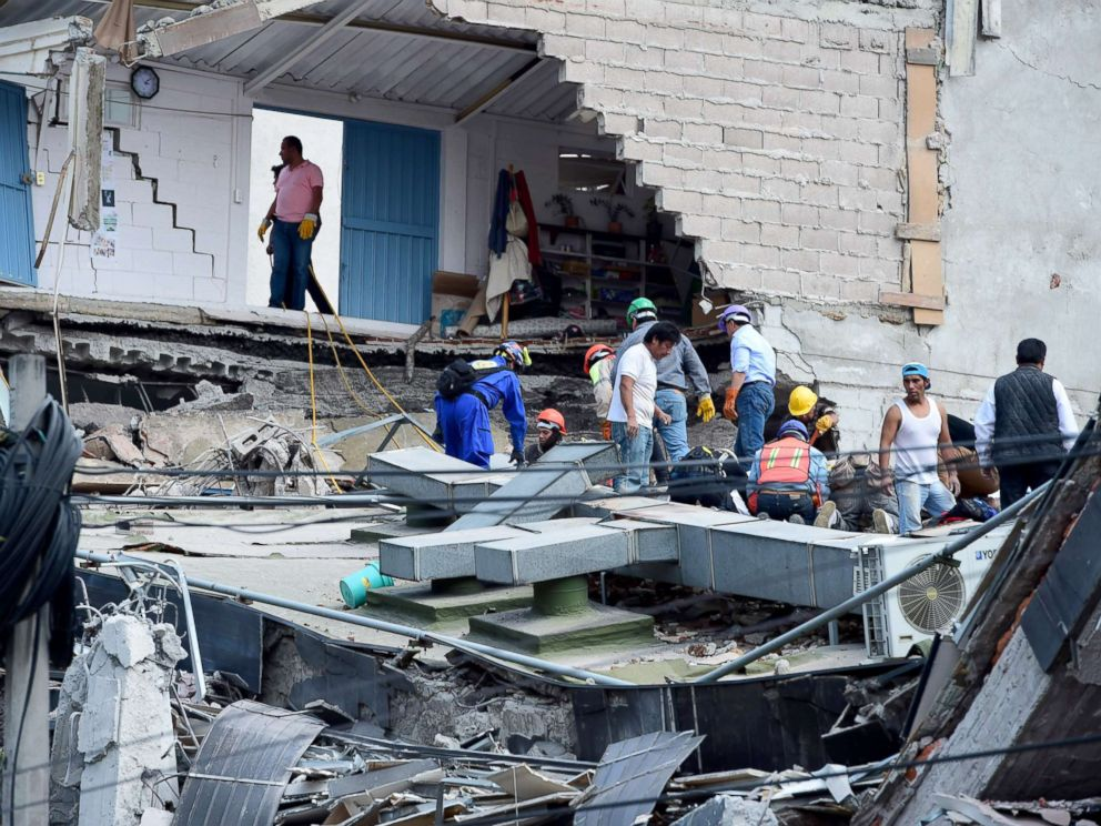 PHOTO: People look for possible victims after walls of a building collapsed during a quake in Mexico City, Sept. 19, 2017.
