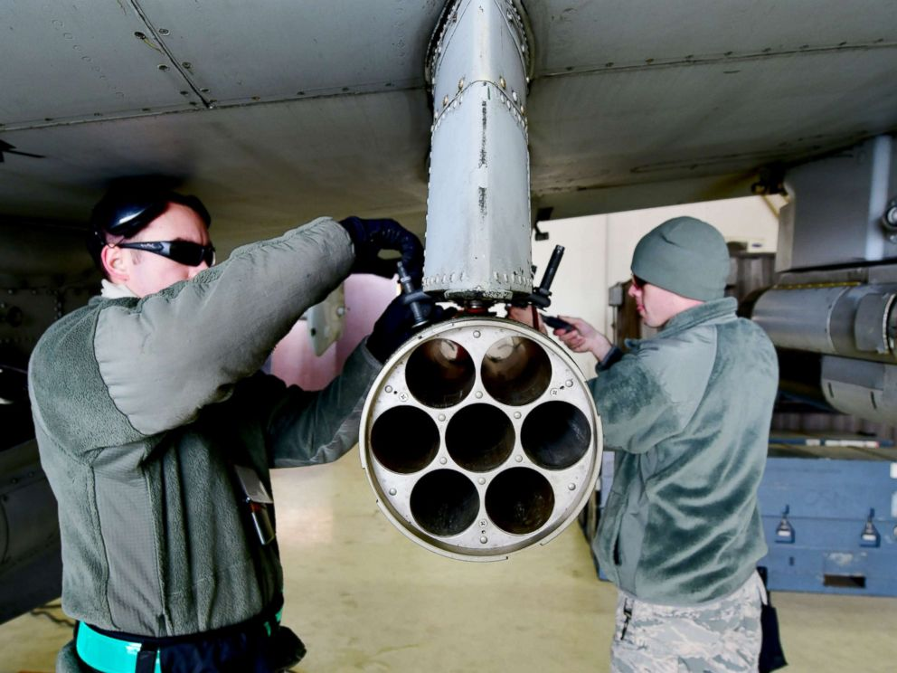 PHOTO: U.S. Air Force Senior Airmen Hamlin Burch and Jacob Wiemers remove a weapon system from an A-10 Thunderbolt II aircraft during exercise Vigilant Ace 18 at Osan Air Base, Republic of Korea, Dec. 2, 2017.