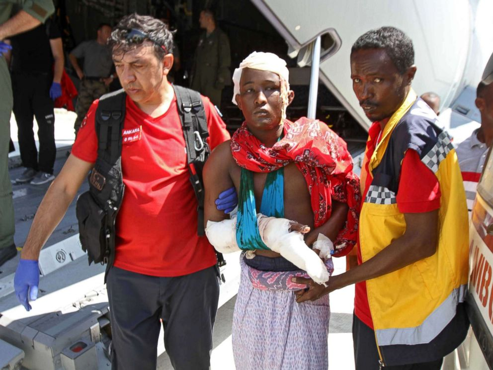 PHOTO: Turkish and Somali paramedics help a wounded man to a Turkish military plane transporting the injured to Turkey at the Mogadishu airport, Oct. 16, 2017, after a truck bomb explosion in the Somali capital. The attack left more than 200 people dead.