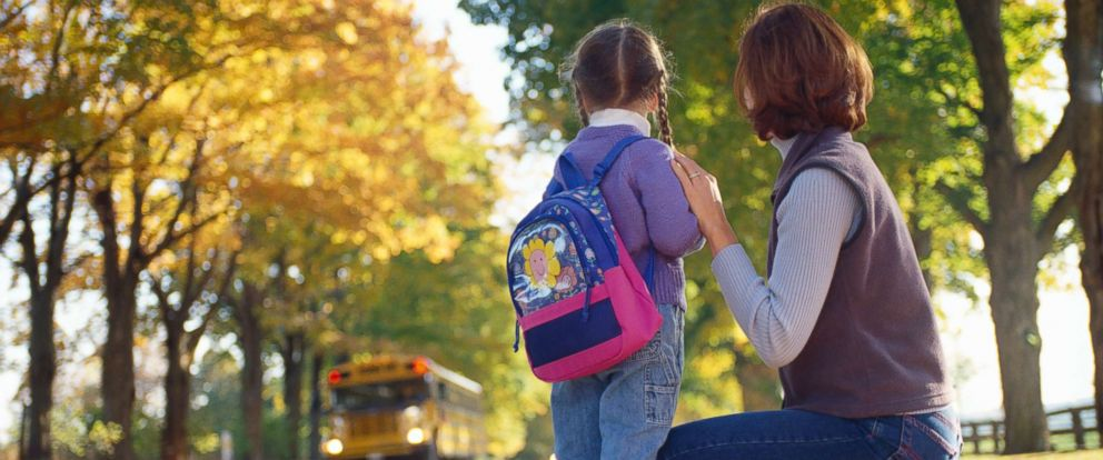 PHOTO: A mother and her daughter wait for the school bus in this undated photo.