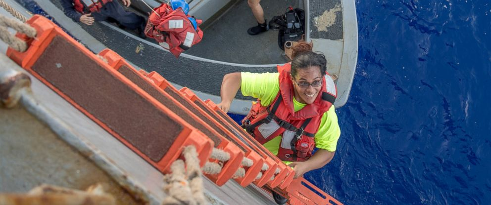 PHOTO: Tasha Fuiaba, an American mariner who had been sailing for five months on a damaged sailboat, climbs the accommodation ladder to board the amphibious dock landing ship USS Ashland (LSD 48), Oct. 25, 2017.