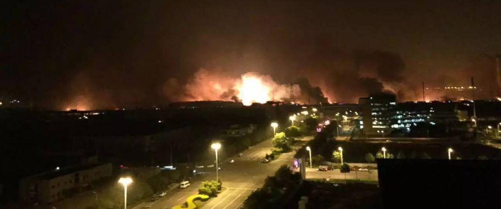 Smoke and fire are seen after an explosion in the Binhai New Area, Aug. 13, 2015, in north Chinas Tianjin Municipality.