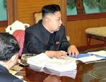 PHOTO: North Korean leader Kim Jong-Un presides over a national defense meeting with his top officials, Jan. 27, 2013.