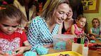 PHOTO: Kristina Schroeder playing with children