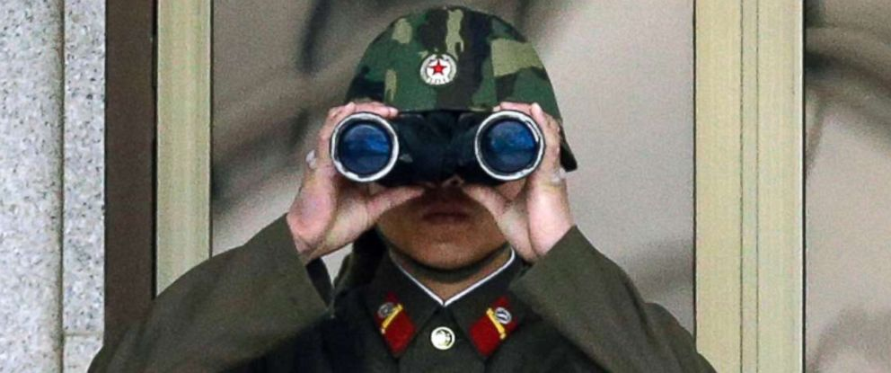 PHOTO: A North Korean soldier looks at the southern side through a pair of binoculars at the border village of Panmunjom, which has separated the two Koreas since the Korean War, in Paju, north of Seoul, South Korea, in this April 23, 2013 file photo.