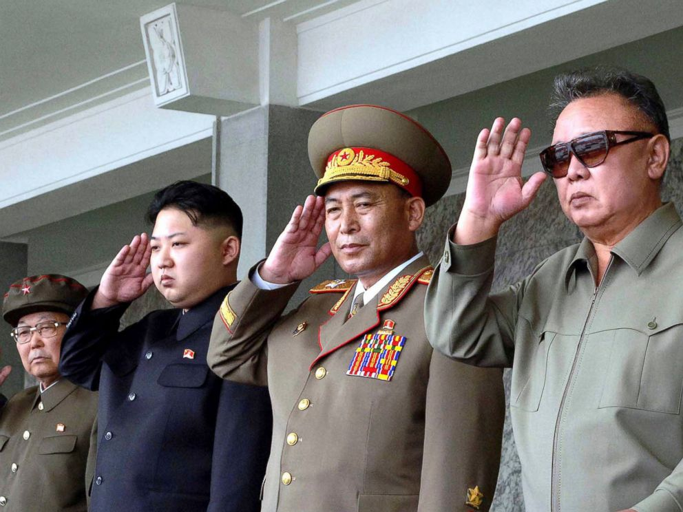 PHOTO: North Korean leader Kim Jong-il , right, and his son Kim Jong Un (3rd R) salute as they watch soldiers attending a military parade in the Kim Il Sung square in Pyongyang, Sept. 9, 2011.