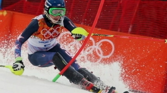 Eighteen-year-old is the youngest person ever to win gold in slalom; Canada beats U.S. in hockey semis.