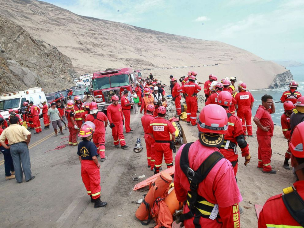 PHOTO: A picture released by Peruvian agency Andina shows firefighters and rescuers working during rescue efforts after a bus plunged over a cliff after colliding with a truck on a coastal highway near Pasamayo, on Jan. 2, 2018.