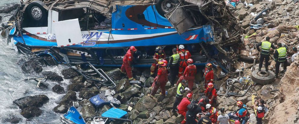 PHOTO: Emergency personnel work to rescue victims after a passenger bus plunged off the Pan-American Highway North, outside of Lima, Peru, Jan. 2, 2018.