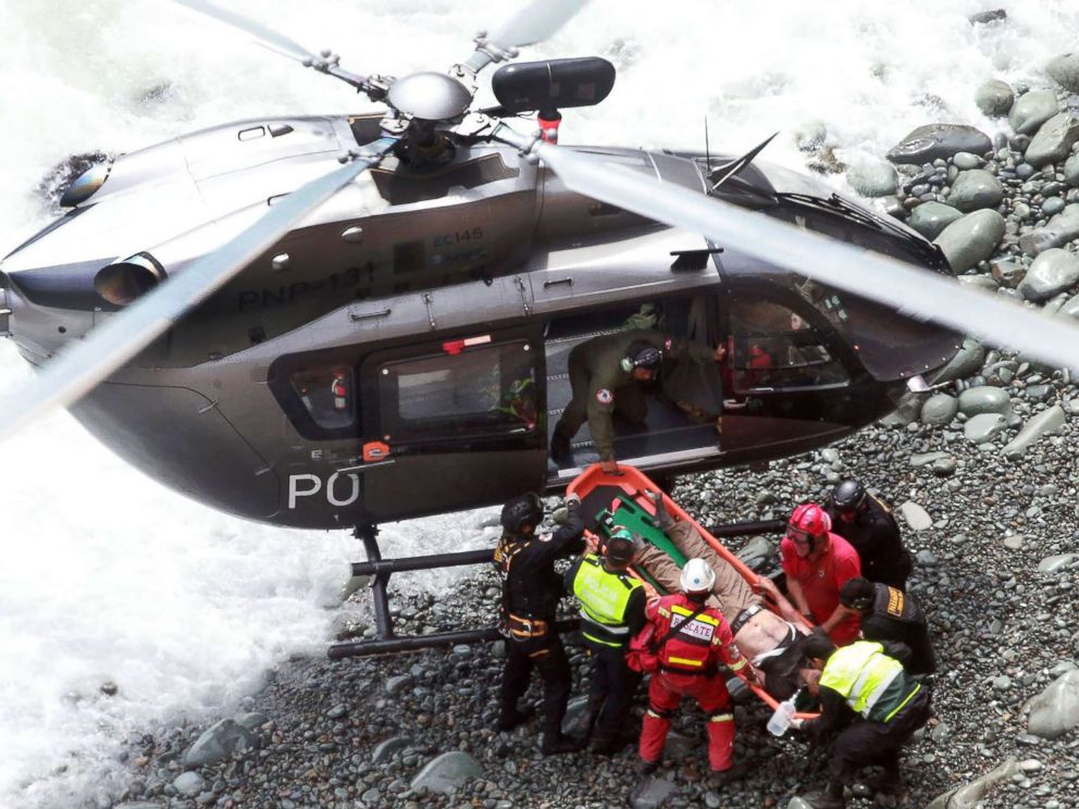 PHOTO: Emergency personnel load a victim onto a helicopter during rescue operations after a passenger bus plunged off the Pan-American Highway North, outside of Lima, Peru, Jan. 2, 2018.