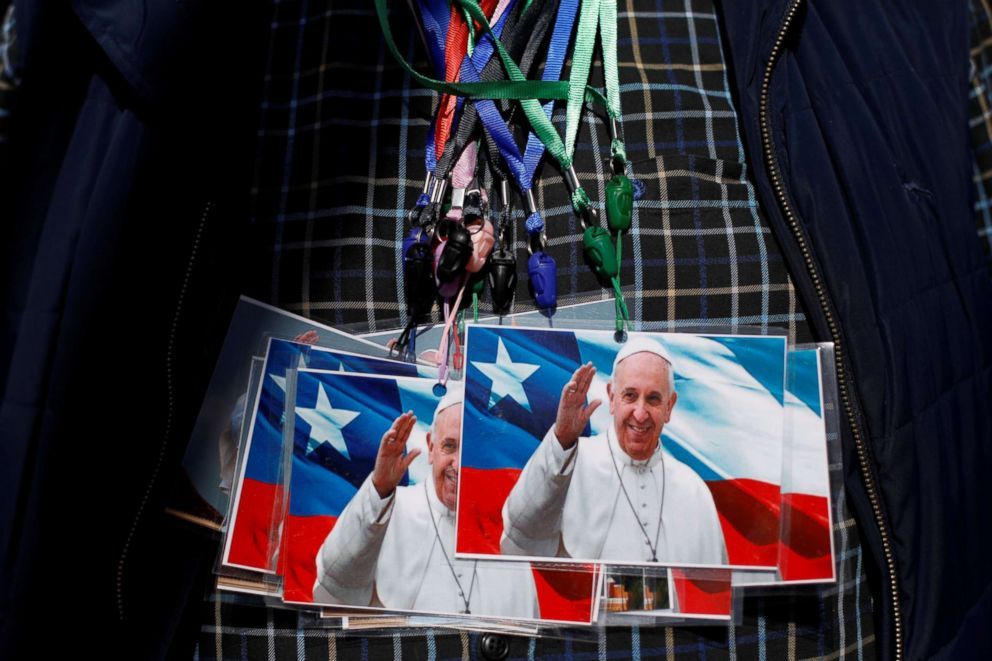 PHOTO: A man exhibits on his chest photos of Pope Francis to sell outside St. Jose Cathedral ahead of the papal visit in Temuco, Chile, Jan. 14, 2018.