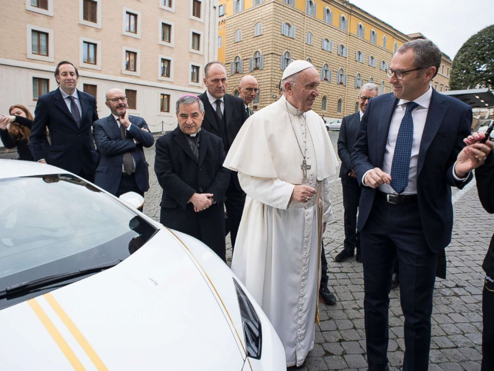 PHOTO: This handout photo taken Nov. 15, 2017, released by the Vatican press office, Osservatore Romano, shows Pope Francis speaking with Lambhorgini CEO Stefano Domenicali (R) after receiving a Lamborghini Huracan as a gift from the Italian car company.