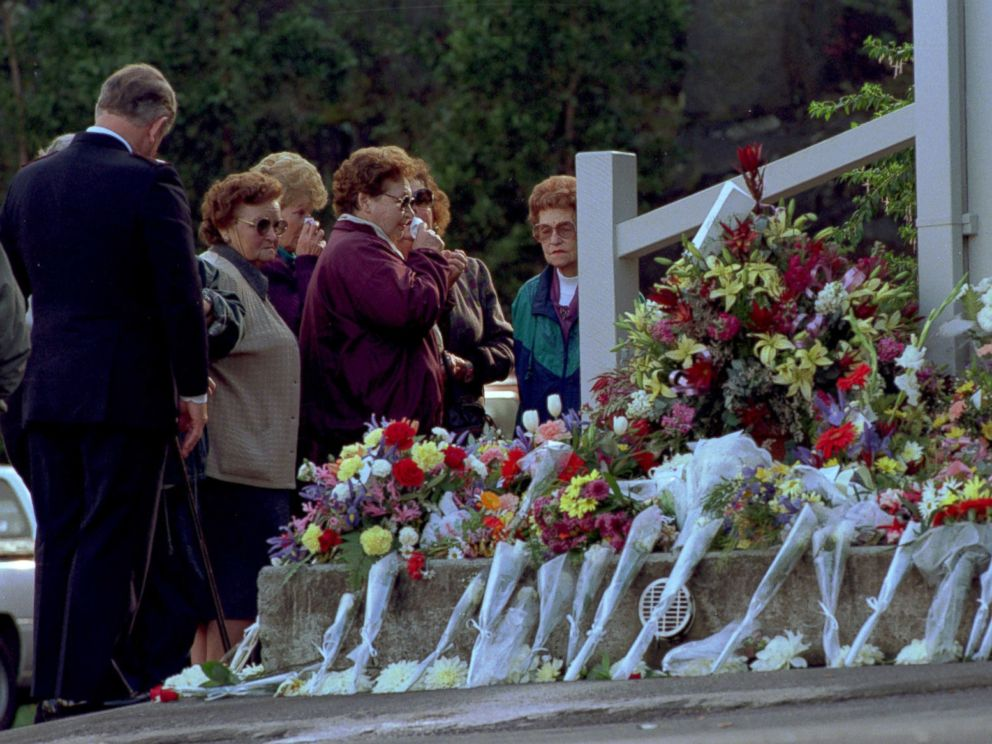 PHOTO: Mourners place flowers outside the the Broad Arrow cafe at the Port Arthur historic site as a memorial to the 35 people shot and killed by a lone gunman at the site during the Port Arthur massacre,May 5, 1996.