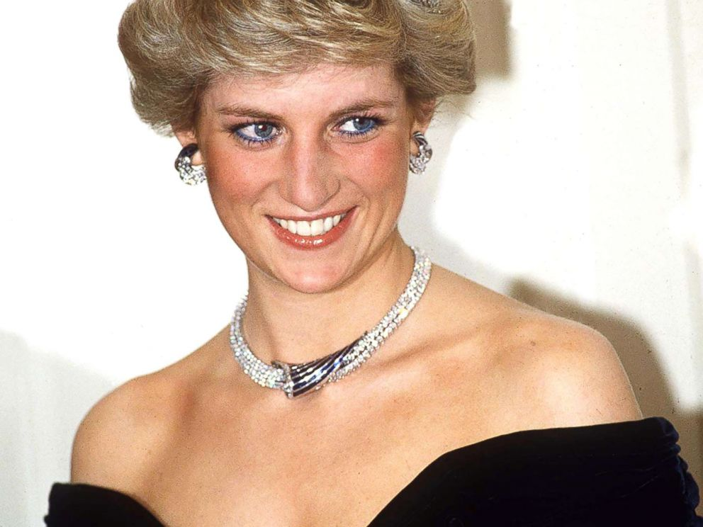 PHOTO: Princess Diana poses in Bonn, Germany, wearing sapphire and diamond jewels which were a gift from the Sultan of Oman (the Tiara is her own) with a dress designed by Victor Edelstein.