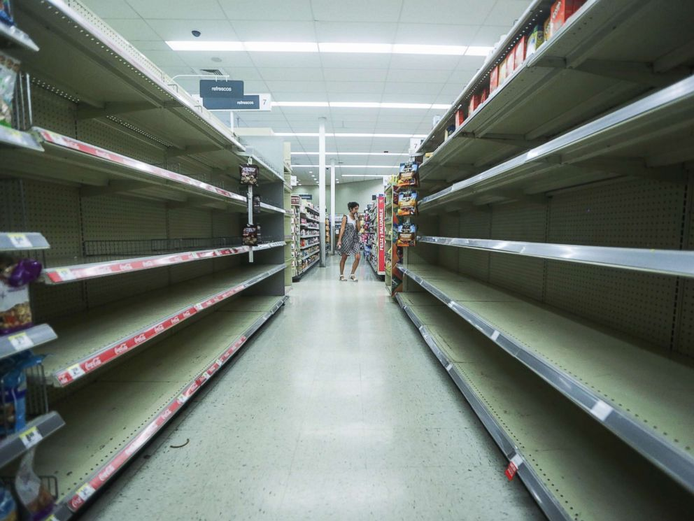 PHOTO: Beverage shelves stand mostly empty in a Walgreens store over three weeks after Hurricane Maria hit the island, Oct. 13, 2017 in San Juan, Puerto Rico.