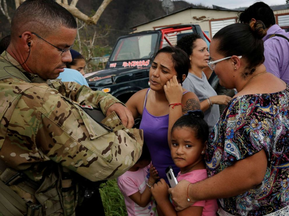 PHOTO: Sergeant First Class Eladio Tirado from the First Armored Divisions Combat Aviation Brigade, who is from Puerto Rico, speaks with residents as he helps during recovery efforts following Hurricane Maria, in San Lorenzo, Puerto Rico, Oct. 7, 2017.