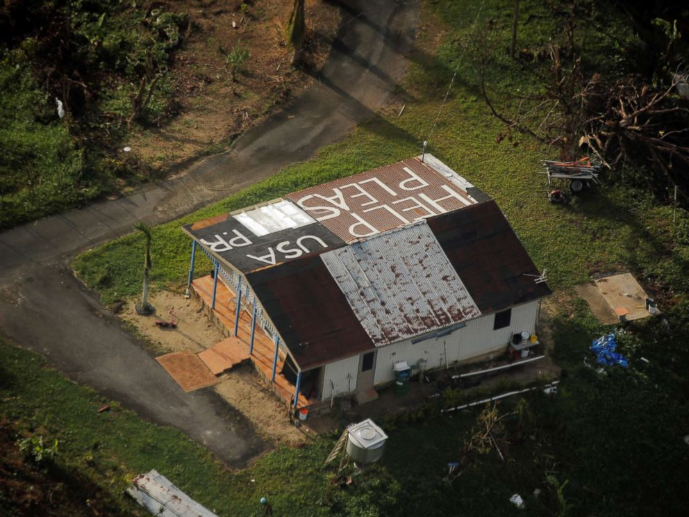 PHOTO: A message written on the rooftop is seen from the air during recovery efforts following Hurricane Maria near Humacao, Puerto Rico, Oct. 10, 2017.