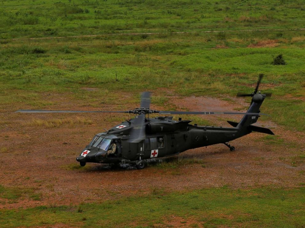 PHOTO: An HH-60 Blackhawk helicopter from 101st Airborne Divisions Dustoff unit lands in a field to avoid lightning during recovery efforts following Hurricane Maria, in Manati, Puerto Rico, Oct. 5, 2017.
