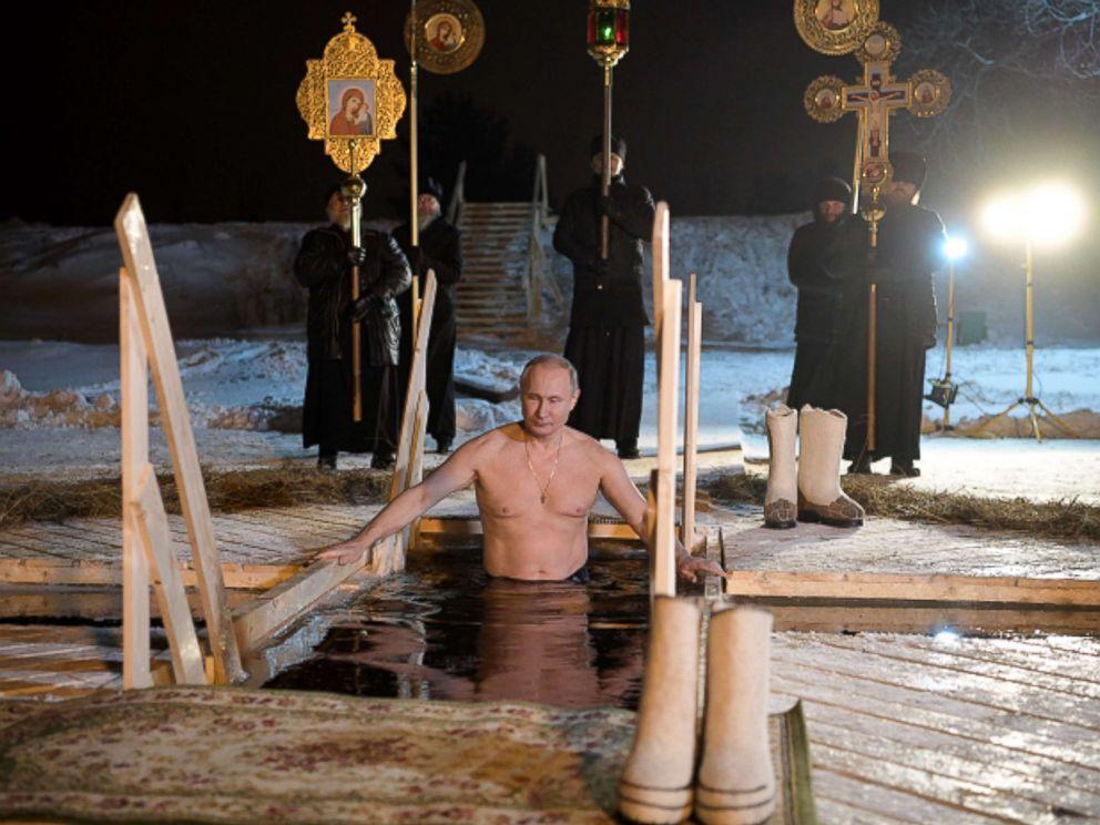 Vladimir Putin takes dip in freezing water to mark Epiphany
