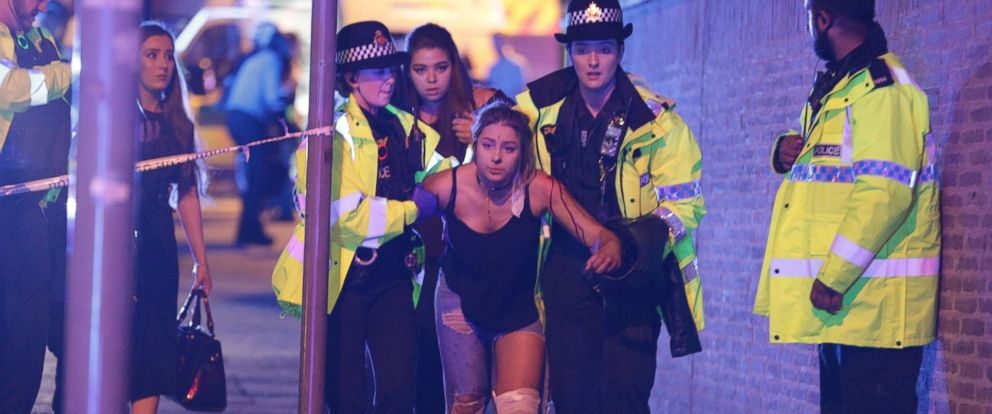 PHOTO: Police and other emergency services assist an injured woman near the Manchester Arena after reports of an explosion, May 22, 2017.
