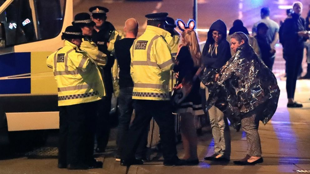 PHOTO: Emergency services personnel speak to people outside Manchester Arena after reports of an explosion at the venue during an Ariana Grande concert in Manchester, England, May 22, 2017.