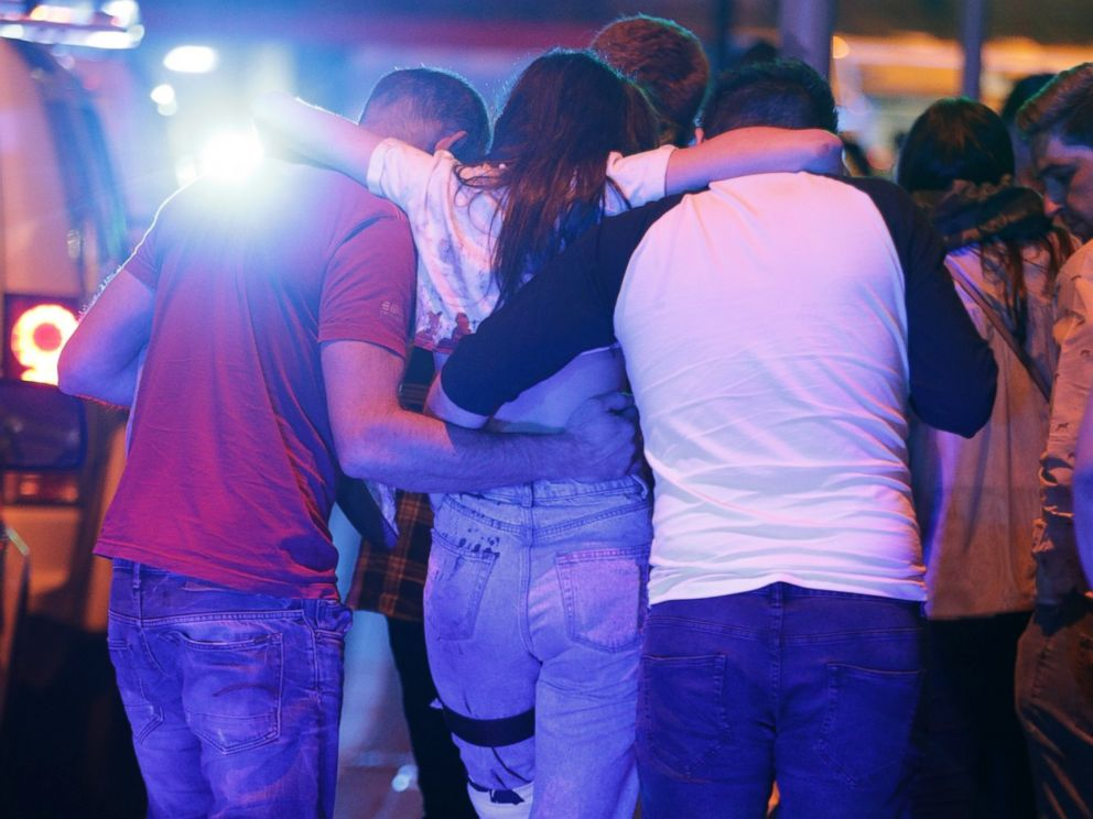PHOTO: People help an injured woman walk near the Manchester Arena after reports of an explosion on May 22, 2017 in Manchester, England.
