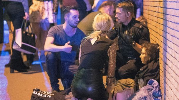 PHOTO: People gather near the Manchester Arena after reports of an explosion on May 22, 2017 in Manchester, England.