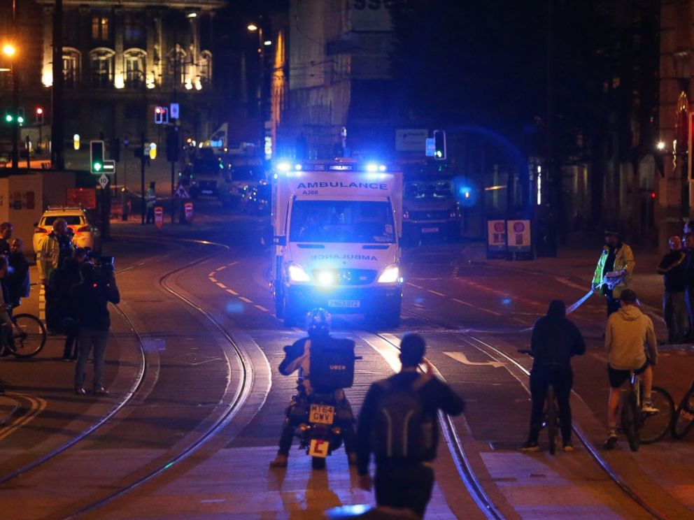 PHOTO: People watch an ambulance pass in the street near Manchester Arena after reports of an explosion in Manchester, England, May 23, 2017.
