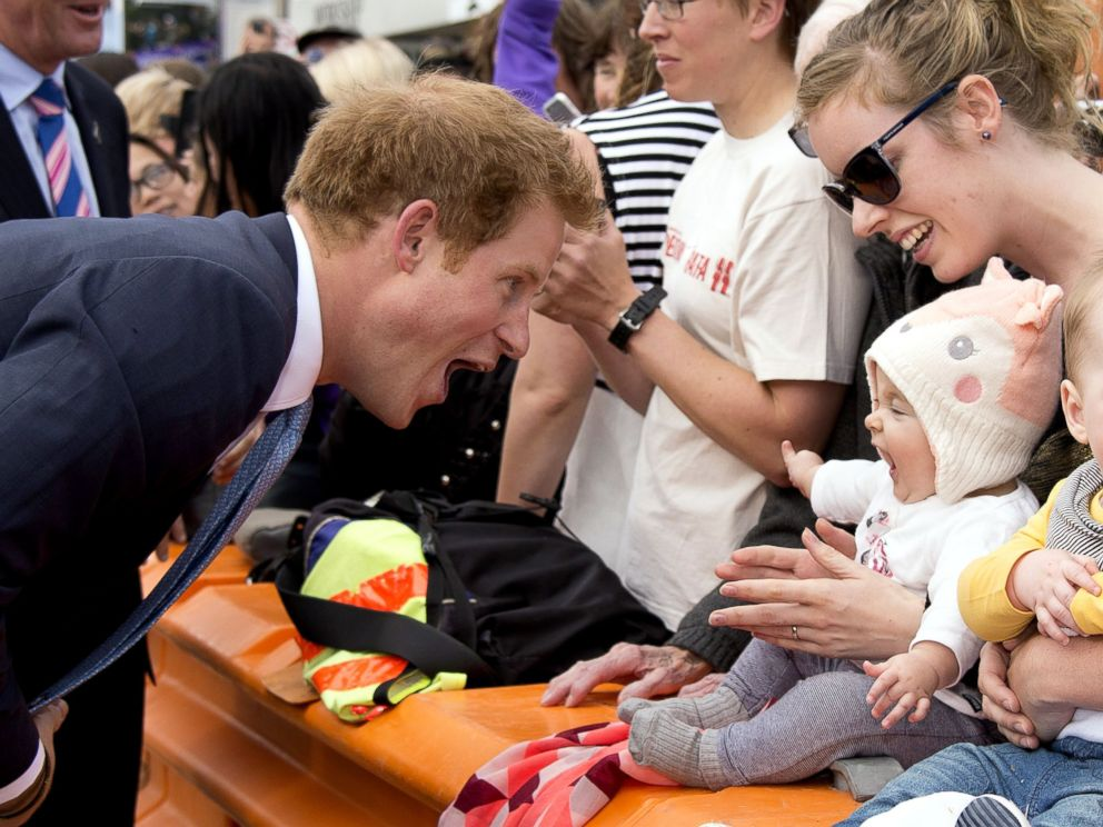 PHOTO: Prince Harry greets a baby at Cashel Street Mall in Christchurch, New Zealand, May 12, 2015.