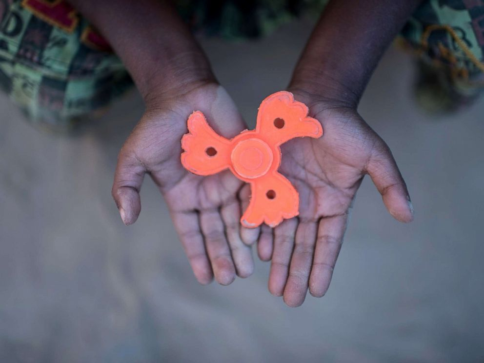 PHOTO: Rohingya migrant boy Mohammad Sadek (5) holds a plastic fidget spinner that he found discarded, at Thankhali refugee camp in Coxs Bazar, Dec. 2, 2017.