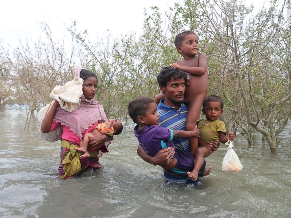 PHOTO: Rohingya refugees walk on the water after crossing the Naf River with an improvised raft to reach Bangladesh in Teknaf, Bangladesh on Nov. 12, 2017.
