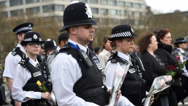 PHOTO: Police officers carry flowers during an event to mark one week since a man drove his car into pedestrians on Westminster Bridge then stabbed a police officer in London, March 29, 2017.