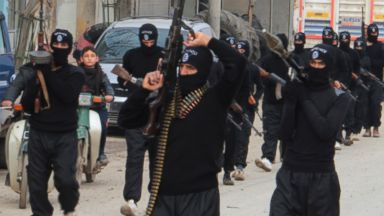 PHOTO: Fighters of al-Qaeda linked Islamic State of Iraq and the Levant carry their weapons during a parade at the Syrian town of Tel Abyad, near the border with Turkey, Jan. 2, 2014.