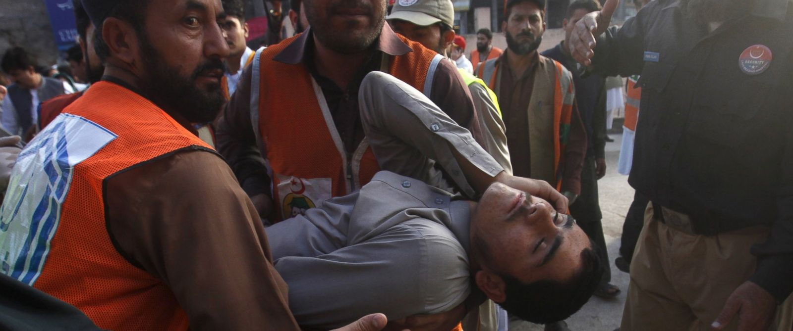 PHOTO: Rescue workers carry a man, who was injured during an earthquake, at the Lady Reading hospital, Peshawar, Pakistan, Oct. 26, 2015.