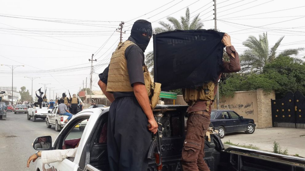 PHOTO: Fighters of the Islamic State of Iraq and the Levant (ISIL) celebrate on vehicles taken from Iraqi security forces, at a street in city of Mosul, June 12, 2014.