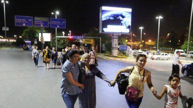 PHOTO: People walk away from Istanbul Ataturk Airport, Turkey, following a blast June 28, 2016.