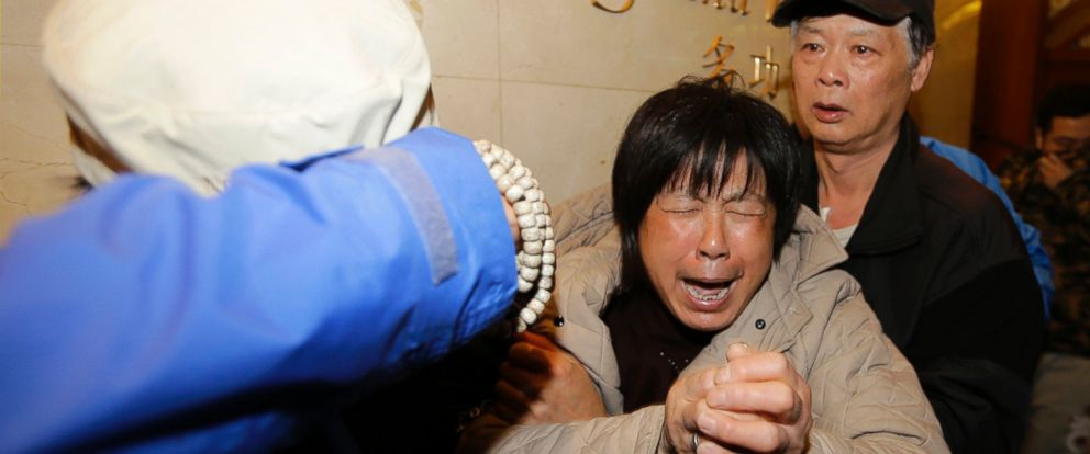 PHOTO: A family member of a passenger aboard Malaysia Airlines flight 370 cries after watching a television broadcast of a news conference, at the Lido hotel in Beijing, March 24, 2014.