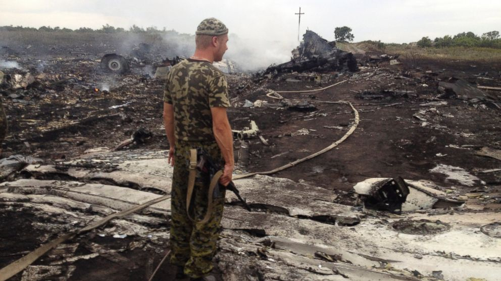 armed pro Russian separatist stands at a site of a Malaysia Airlines