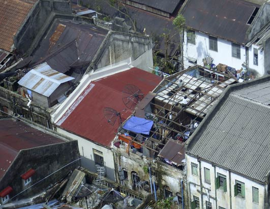 An aerial photo shows damage to rooftops of residential buildings in Yangon