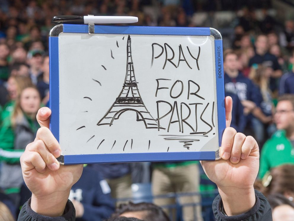 PHOTO: A student holds a sign in recognition of the attacks in Paris before the game between the Notre Dame Fighting Irish and the St. Francis Red Flash at the Purcell Pavilion on Nov. 13, 2015, in South Bend, Ind.