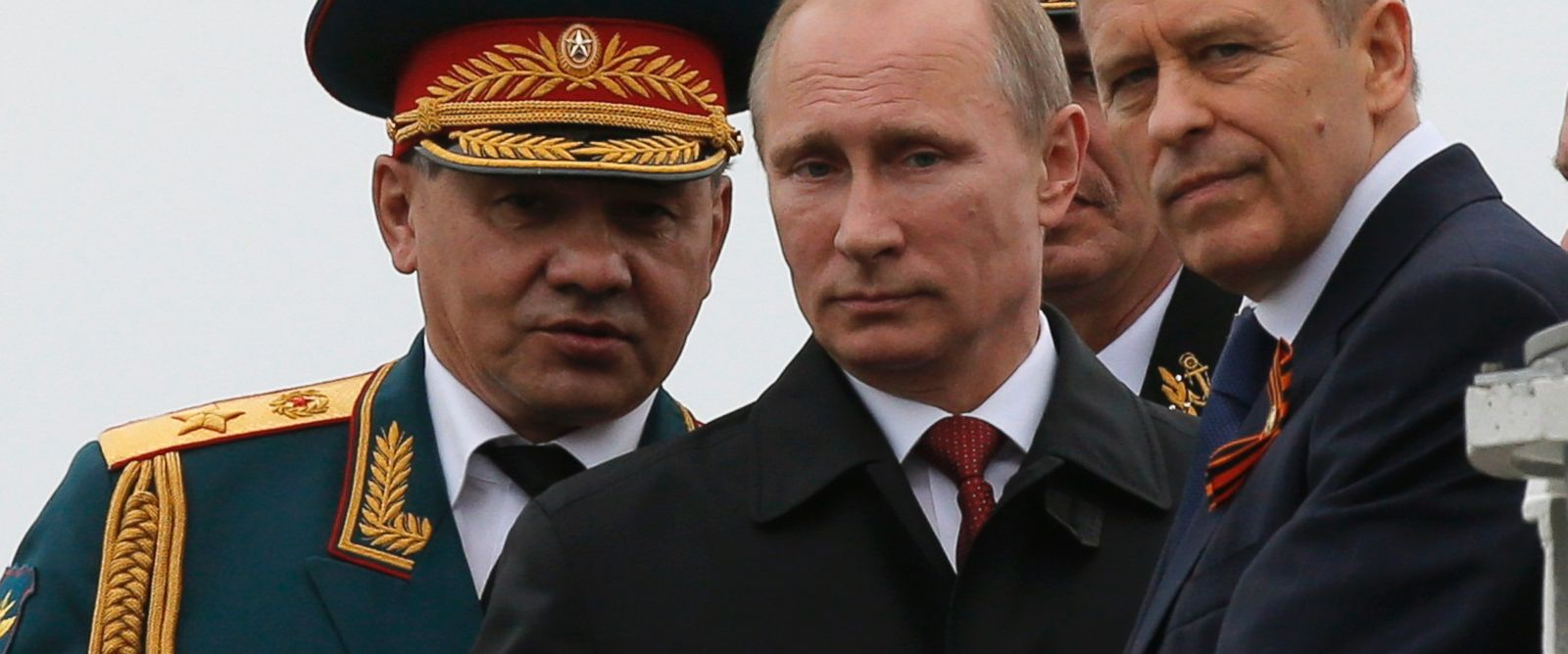 PHOTO: Russian President Vladimir Putin, center, Defence Minister Sergei Shoigu, left, and Russias Federal Security Service Director Alexander Bortnikov watch events to mark Victory Day in Sevastopol May 9, 2014.