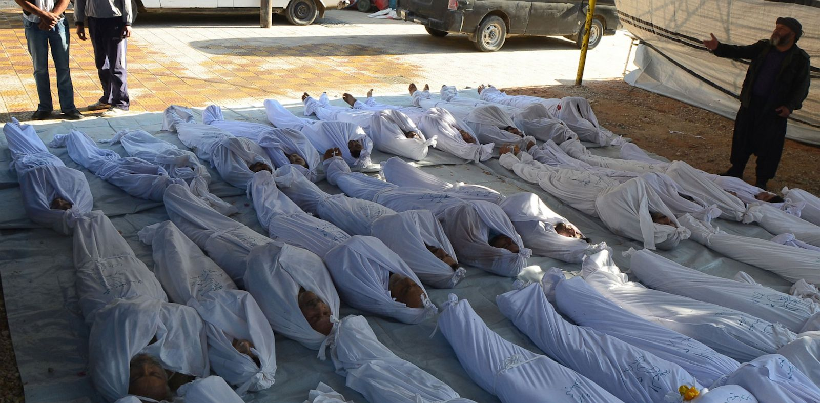 PHOTO: Syrian activists inspect the bodies of people they say were killed by nerve gas in the Ghouta region, in the Duma neighborhood of Damascus on August 21, 2013.