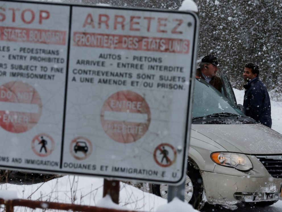 PHOTO: A man who told police he was from Sudan talks to his taxi driver after being told by Royal Canadian Mounted Police officers to go to the Lacolle border, at a U.S.-Canada border into Hemmingford, Quebec, Feb. 13, 2017.
