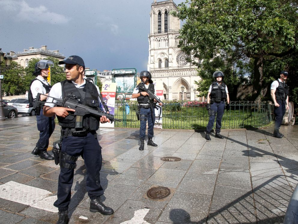 PHOTO: French police stand at the scene of a shooting incident near the Notre Dame Cathedral in Paris, June 6, 2017.