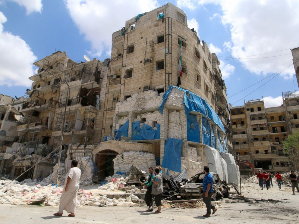 PHOTO: People inspect the damage at al-Quds hospital after it was hit by airstrikes, in a rebel-held area of Syrias Aleppo, April 28, 2016.