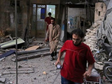 PHOTO: Medics inspect the damage outside a field hospital after an airstrike in the rebel-held al-Maadi neighborhood of Aleppo, Syria, Sept. 28, 2016.
